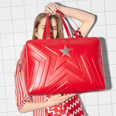 Creating an optical illusion, floating dresses feature zig zag and stripe motif in hot chili red. The #StellaStar bag is bigger and bolder in a new holdall shape.