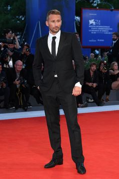 """Matthias Schoenaerts wearing a Louis Vuitton tuxedo from the Fall-Winter 2017 Collection to the """"Racer and The Jailbird"""" Premiere during the 74th Venice Film Festival in Venice, Italy."""