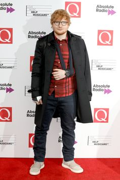 Q Awards winner Ed Sheeran wears a Burberry check shirt, jeans and cashmere trench coat to the event in London