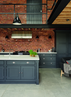 Tom Howley - Hartford Industrial Style Shaker Kitchen with industrial lighting and stainless steel appliances.