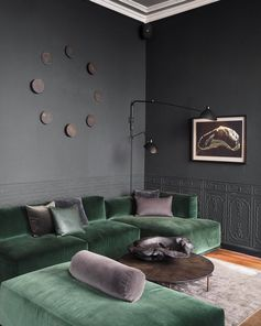 green velvet sofa and grey walls