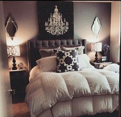 Mirrors, bedside tables, cuvet covers and pilliows, picture behind the bed