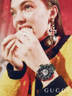 Appearing in the Gucci Gift campaign shot by Petra Collins, the new Gucci Dive watch features a logo-embossed rubber strap with a symbolic motif of the House—the feline head.