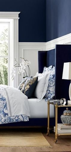 Navy Blue Bedroom.  Love the blue headboard and floral bedding.