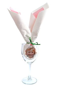 Napkin Bunny Ears Place Setting - add a photo to a folded napkin for a personalized place setting that will look cute on your Easter table. You can even use photos on your phone by printing them using the My Kodak Moments app.