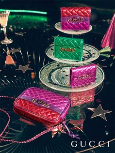 Photographs of the Gucci Gift party capture metallic leather accessories featuring the Interlocking G Horsebit—a symbol that merges two of the House's most distinctive codes into one.