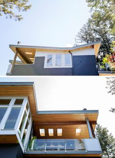 This modern multi-storey house features a butterfly roof, huge overhangs, clear hemlock soffits and ceilings that continue from inside to outside, wood cladding in a deep navy colour, and vertical galvanized corrugated steel siding. #ModernHouse #Architecture #ButterflyRoof