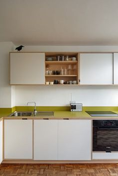 Love birchwood, ply & formica kitchens from Uncommon Projects, this is in a Span house