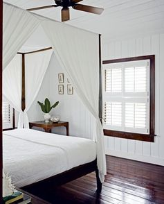 White and mahogany bedroom via Arch Digest.