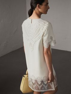 An elegant silk shift dress framed by romantic embroidered tulle and a macramé lace motif at the back. Inspired by the runway collection, the loose-fit design is finished with scalloped sleeves. Style with pastel-coloured accessories.