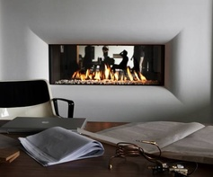 Desk work will be much more fun with the flames on. Built in fireplace on gaz. © Tulp