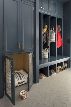 Indigo blue and brass mudroom with a custom dog kennel(I wouldn't do the dog kennel bc my dogs never would sleep in the mud room). But a long closed cabinet would be smart.