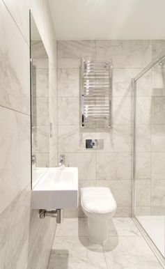 A small bathroom with walk-in shower.