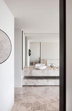 A modern bathroom with limestone vanity and floors.