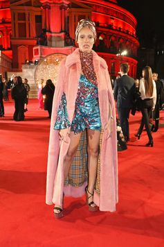 Adwoa Aboah in a  pale pink full-length faux fur cape from Burberry for the 2017 Fashion Awards in London