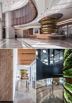 An office interior with large vertical gardens that are in the shape of columns.