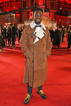 In Burberry outerwear, Tinie Tempah on the red carpet at the 2017 Fashion Awards in London