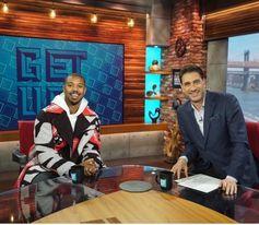 Michael B Jordan wearing a No Smile No Service Stella Menswear coat.