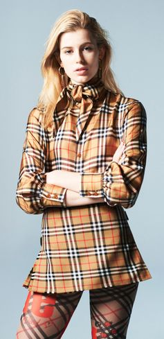 Claudia wears the #VivienneWestwoodandBurberry Vintage Check Silk Shirt and the Vintage Check Wool Mini Skirt