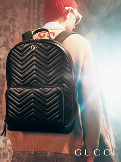 A new backpack shape for the GG Marmont in chevron patterned matelassé vintage look leather, captured in the Gucci Gift campaign by Petra Collins.  B36:B37