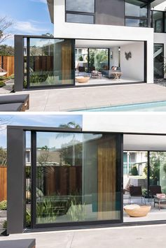 A full-height wall-to-wall glass door with a black frame, opens up the living room of this modern house and connects it to the patio that surrounds the pool. #GlassWall #Architecture #SlidingWall #ModernHouse