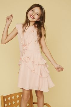 Fluttering angel wing sleeves and dainty ruffles create an endlessly charming dress she'll want to wear time and again.