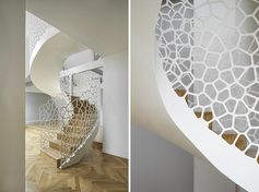 This Parisian apartment features an artistic white spiral staircase with organic cell-like shapes for the balustrade. #SpiralStaircase #WhiteSpiralStairs #WhiteStaircase #SculpturalStairs #ArtisticStairs