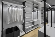 This modern and large walk-in closet has plenty of room for hanging clothes and storing shoes. A mirror on the end wall makes the space feel larger, while the rods have hidden lighting to show off the clothes and brighten the space. #WalkInCloset #Closet #Wardrobe #WalkInWardrobe