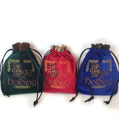Our Bag of Holding is absolutely gorgeous-- decked out in Royal Velvet colors of either Green, Red or Blue. It is adorned with a beautiful embroidered design using high quality thread. These bags are hardy and sturdy.....just roll down the top and your bag will sit beside you, your constant
