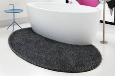 A carpet or a rug in the bathroom? Why not! This one, named Maya by Carpet Sign, is designed especially for the bathroom. Design by JEE-O.
