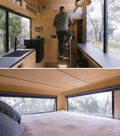 In this modern tiny house, a ladder provides access to the loft that features a king size bed. Black roller blinds can be closed for privacy when needed. #TinyHouseLoft #TinyHouseBed #TinyHouseWindows