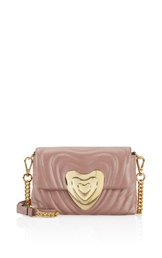 Introducing the new Escada signature bag, exquisitely crafted from leather matelassé finished by a golden heart-shaped clasp. A chic and compact accessory for day as well as evening, fitted with a chain-trimmed strap that's adjustable so...