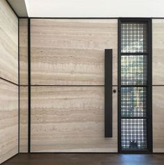 Front Door Ideas - This modern front door has a brass woven ribbon mesh exterior, and a travertine slab interior. #ModernFrontDoor #DoorIdeas #FrontDoor