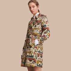 A tailored cotton trench coat reworked with a vivid all-over print taken from Henry Moore's drawing 'Reclining Figures' 1937, chosen from the Henry Moore Foundation archive. The double-breasted design is tempered with signature details including epaulettes, belted cuffs and a storm shield.