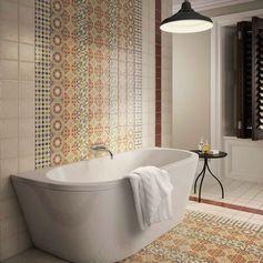 des carreaux de ciment patchwork qui investissent le sol et le mur de cette salle de bains zen