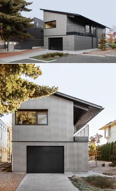 A modern house with an angular shed roof, corrugated metal siding, and black accents.