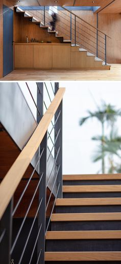 Industrial touches like this steel and wood stairs with a matching handrail, connect two levels of a modern marketing suite made from multiple shipping containers. #Stairs #SteelStairs #StairDesign #ModernStairs
