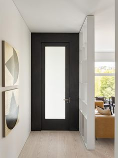 A black framed front door.
