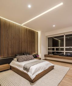 An Accent Wall Of Vertical Wood Helps To Accentuate The Feeling Of Height In This Bedroom