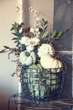 We LOVE this soft, muted, fall look for Thanksgiving! Learn how to create this DIY pumpkin-floral display piece!