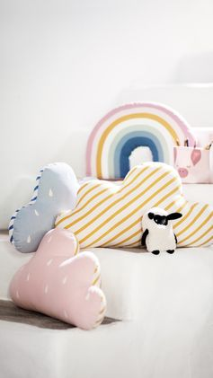 H&M HOME | Bring on bedtime! These adorable cloud and rainbow cushions will set your little one's up for a magical night's sleep.