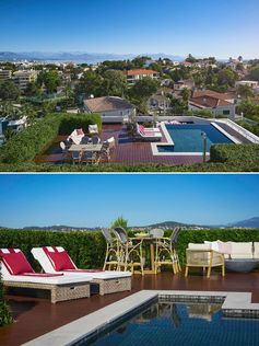 A rooftop terrace with a swimming pool, outdoor lounge, dining area, and sunbed loungers.