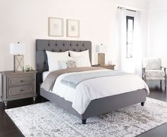 Grey upholstered fabric bed frame. This stunner showcases hand-applied diamond tufting with full fabric folds, as well as individually-applied nail head accents. Durable steel slats also ensure extraordinary support while you're sleeping. Best of all, it's offered at a brag-worthy price. #homedesign #bedroomdesign #bedrooms #bedroomdecor