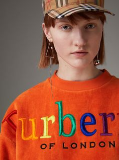 A sweatshirt in velvety towelling updated with 'Burberrys' embroidery in a rainbow of colours, first seen on the #Burberry runway