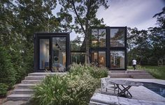 MB Architecture has designed a modern shipping container house for a family of five, that's located on a wooded site in Amagansett, New York. #ShippingContainerHouse #BlackHouse #ModernHouse #ModernArchitecture #ShippingContainer #Landscaping
