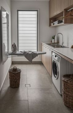 Designing the ultimate laundry, all the tips and tricks you need! Luxury laundry with ironing centre built into the wall. Timber cabinetry and sleek finishes #laundryroom #renos #ideas #clairekcreations