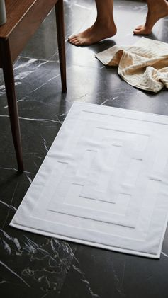 H&M HOME | Step straight from the shower onto a soft, white organic cotton bath mat — lovely!