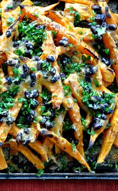 ¡Hola! Jalapeño: Sweet Potato Nachos with Smoked Cheddar and Black Beans - Caramelized roasted sweet potato fries topped with creamy black beans and smoked cheddar cheese. Yum!