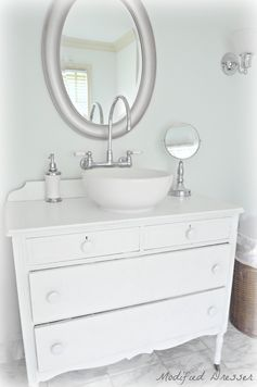 Dresser turned into Bathroom Vanity. Using customers old dresser, we retrofitted a porcelain bowl sink and added plumbing. Design and fabricated by Bryan Construction, Inc. www.BryanBuilds.com
