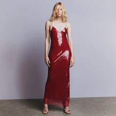 Emblazoned in sequin embroidery, the simple slip dress is transformed into sexy eveningwear with a laid-back attitude.